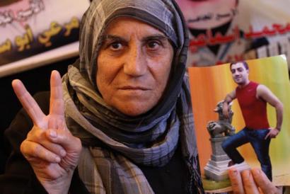 Palestinako emakumea, Israelek atxilotutako senideak askatzeko eskatzen irailaren 8ko protesta batean (Mohammed Asad / APA images)