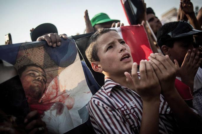 Altxamendu militarraren aurkako protestetako argazkia, Kairon.